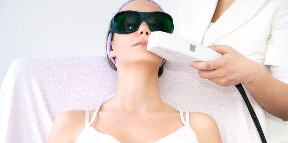 Woman during laser hair removal treatment