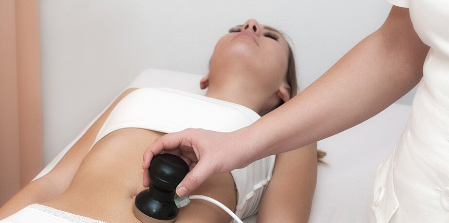Woman undergoing ultrasound cavitation
